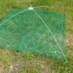 Green umbrella net in the grass